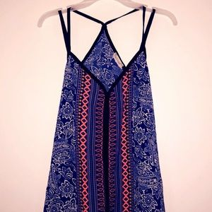 A floral and Aztecan print strappy shirt